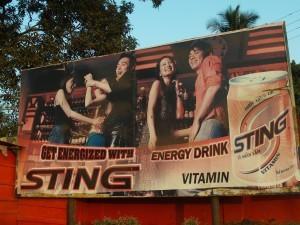 Billboard promoting energy drinks in Freetown, Sierra Leone