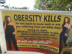 Billboard in Ghana promoting an undisclosed solution for obesity. Photo credit: Anna-Sarah Eyrich