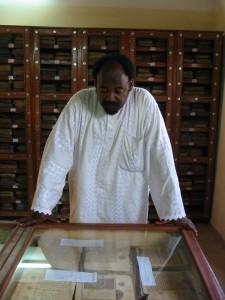 Abdelkader Haidara inspects ancient manuscripts in his Mamma Haidara Library in Timbuktu