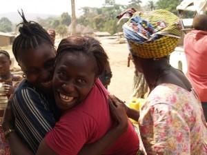 2008-02-05-031resettlement-two-women-embraze-Kissy-Town-village-H-300x225