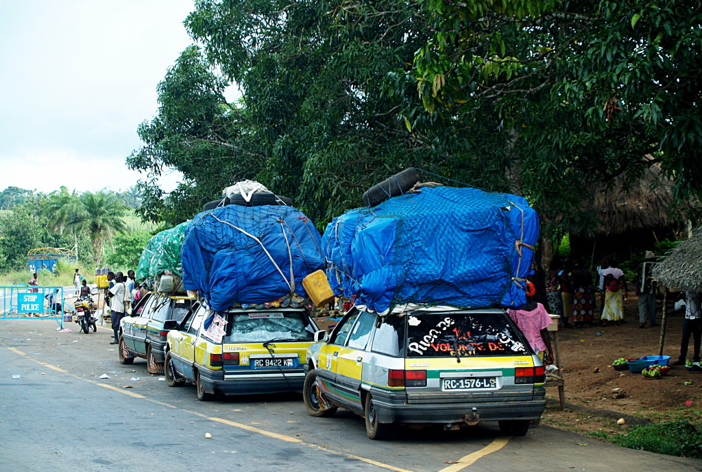 (NOT) travelling light . . . bush taxis plying the road between Guinea and Sierra Leone