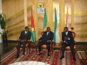 """Blaise Compaore (left) was elevated by Western nations to the status of """"statesman"""" and """"negotiator"""" in West Africa, shown here in 2002 in Bamako, Mali, with former Malian President Amadou Toumani Toure (centre), and former Ivorian president, Laurent Gbagbo (right)"""
