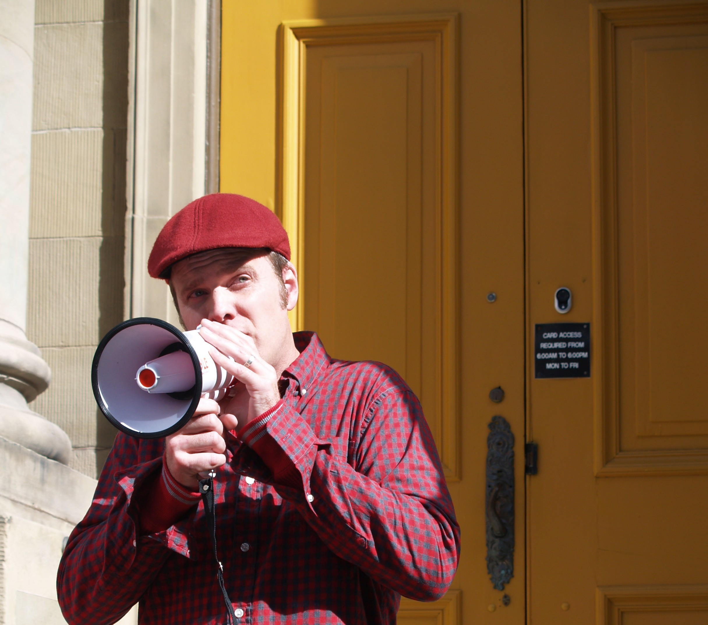 Acclaimed folk singer & songwriter Dave Gunning takes the Clean The Mill message to the NS Legislature, decrying the mill's pollution & also pulp forestry, clear cutting & glyphosate spraying. Photo by Joan Baxter